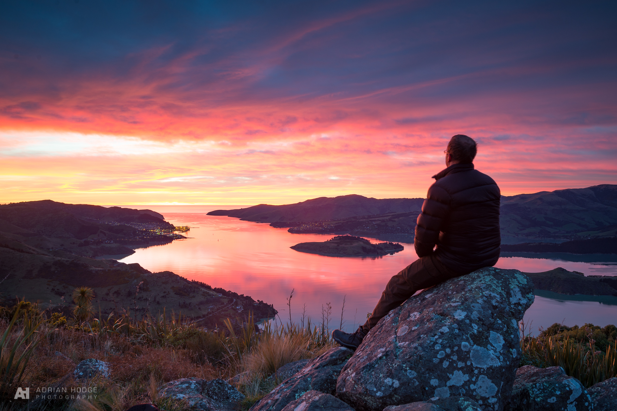 Person watching sunrise over Lyttelton Harbour, Christchurch