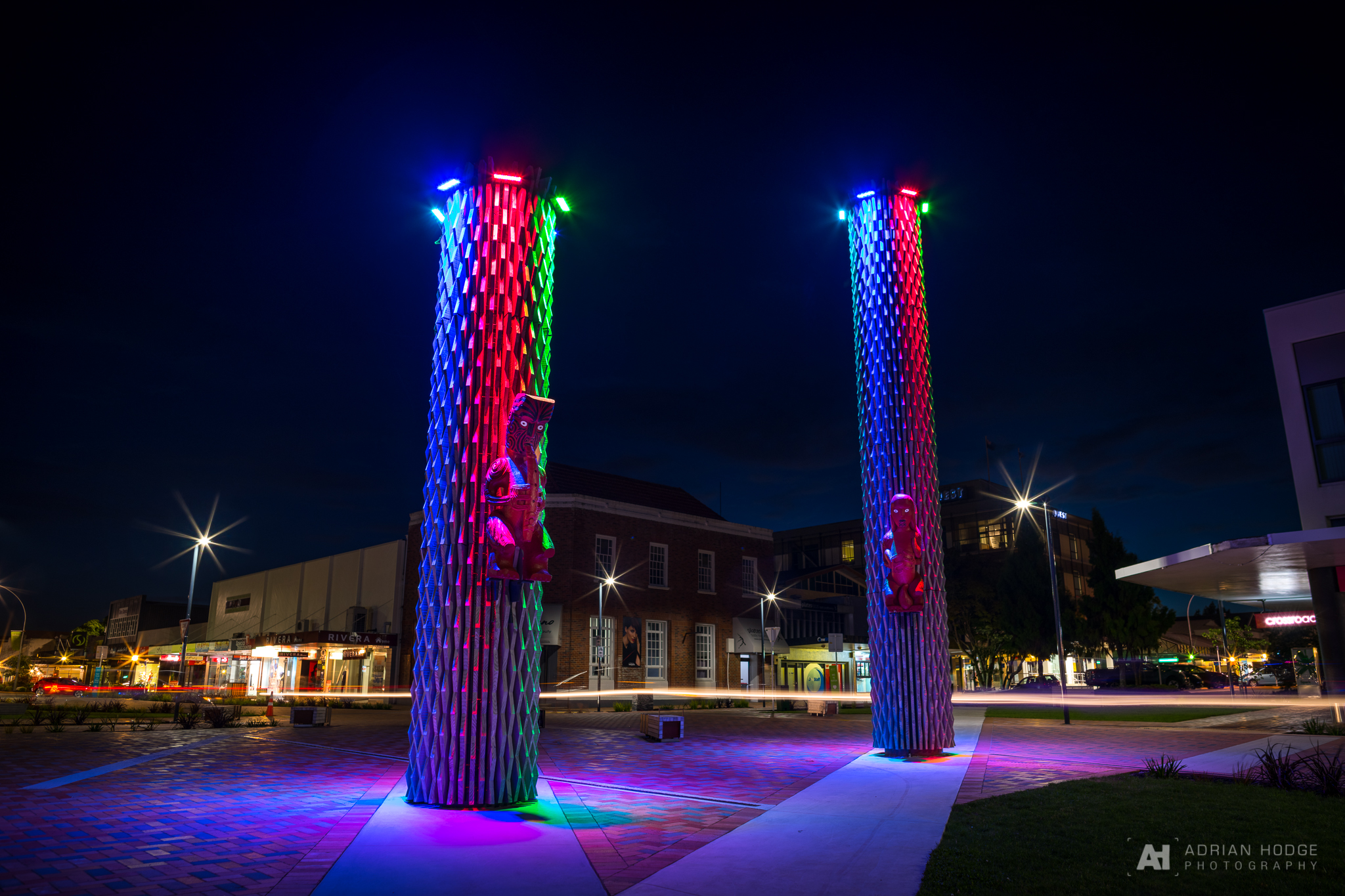 Hinemoa & Tutanekai Carvings adorn two pillars in central Rotorua at night under LED lights