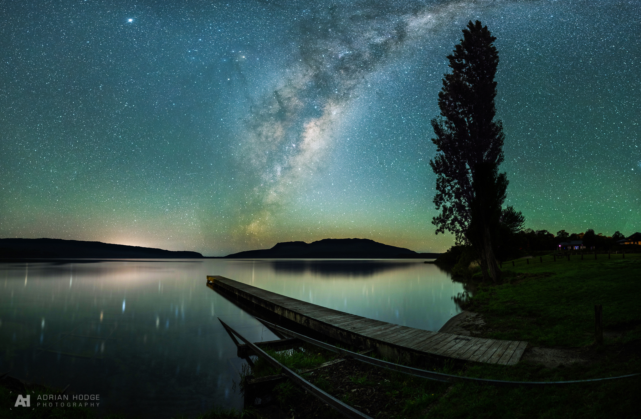 The Milky Way rising above a jetty on Lake Tarawera, Rotorua